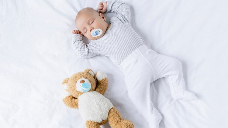 Are you on the fence about using a pacifier for your baby? Pacifiers have had a bad rap over the years, but what's the scoop? Are baby pacifiers good or bad? Learn about the history of pacifiers, the pros, the cons, what the best natural pacifiers are, and other alternatives to soothe baby.